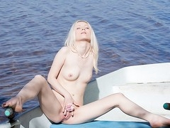 What can a beautiful golden-haired do all alone in a boat in the middle of a lake? Find out in this steamy trickery porn clip!